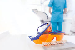 Googles, tools close-up in dentist's office. Dentist at work. Stock Image