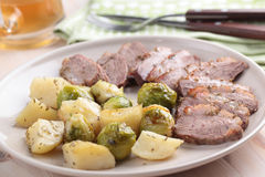Goose breast with vegetables and beer Royalty Free Stock Image