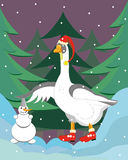 The goose builds a snowman. Royalty Free Stock Image