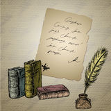 Goose feather , elegant old-fashioned decorative inkpot ,old pap Royalty Free Stock Photography