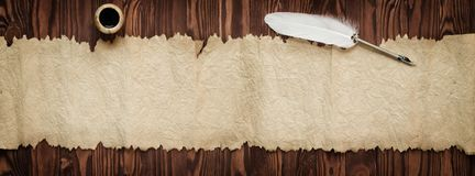 Goose feather and old paper, vintage background for text, panora Royalty Free Stock Photography