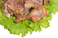 Goose fried. Parts of a fried goose and green salad on a dining table Royalty Free Stock Photo