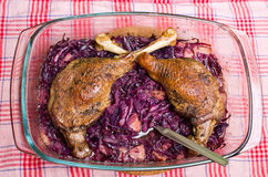 Goose legs baked on red cabbage Stock Image