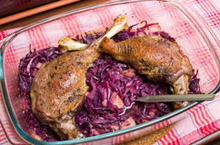 Goose legs baked on red cabbage Royalty Free Stock Photos
