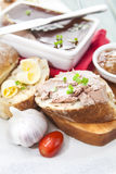 Goose liver and Sauternes pate with chutney, physalis, sliced br Royalty Free Stock Photography