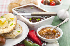 Goose liver and Sauternes pate with peppers, tomatoes, sliced br Stock Photo