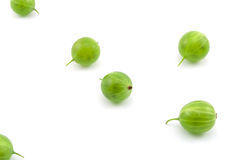 Gooseberries. Green gooseberries on a light background royalty free stock image