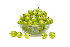 Gooseberries in a glass bowl on a white background. Ripe gooseberry in a glass bowl on a white background Royalty Free Stock Photo