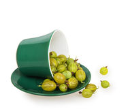 Gooseberries in an inverted green cup on green saucer Royalty Free Stock Photography