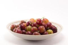 Gooseberries in a saucer stock photography