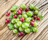 Gooseberries on the wooden. Royalty Free Stock Image