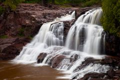 Waterfall on Gooseberry River. Gooseberry Falls, a waterfall on Gooseberry River by the North Shore of Lake Superior, Minnesota, USA Royalty Free Stock Image
