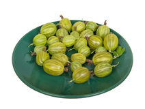 Gooseberry on green saucer Stock Photography