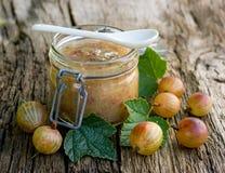Gooseberry jam. Fresh gooseberry jam on wooden ground Royalty Free Stock Image