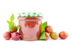 Gooseberry jam. Jar of gooseberry jam with gooseberries on white stock photo