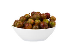 Gooseberry in a plate on a white background Royalty Free Stock Images
