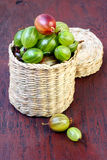 Gooseberry in wicker box Royalty Free Stock Photos