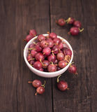 Gooseberry on wooden background Royalty Free Stock Photos