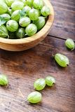 Gooseberry in a wooden plate stock photography