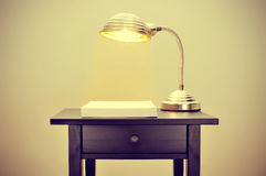 Gooseneck lamp and blank paper sheets Stock Images