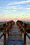 Beachgoers, as well as the gopher tortoise, use the wood boardwalk as a personal freeway to and from the ocean stock photo
