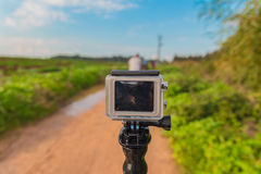 GoPro action camera on stick in dirt road at rural area Royalty Free Stock Photos