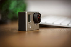 Gopro camera standing on the desk Royalty Free Stock Images