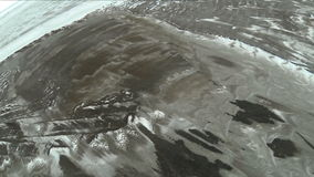 GoPro. Flight quadrocopters over the field. Winter stock footage