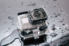 GoPro HERO 5 action camera in waterproof case. Kharkov, Ukraine - April 6, 2017: GoPro HERO 5 action camera in waterproof case under water flow. Compact gadget stock photos