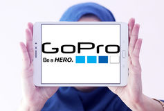 Gopro logo. Logo of camera manufacturer gopro on samsung tablet holded by arab muslim woman Stock Photos