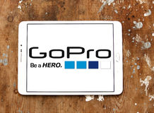 Gopro logo. Logo of camera manufacturer gopro on samsung tablet on wooden background Stock Photos