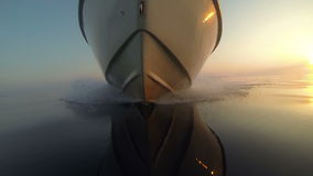 GoPro: View of a speedboat front while gliding on water at sunset stock video