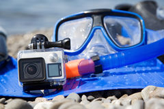 GoPro with waterproof case. And snorkelling gear Stock Photos