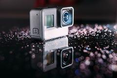 GoProheld 5 digitale actiecamera met fonkelingen Stock Afbeeldingen