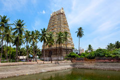 Gopura (tower) and temple tank of Hindu Tempe Stock Photography
