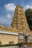 Gopuram of Swetha Varaaha Swamy Devastanam temple at Mysore Pala. Mysore, India - October 27, 2013: Yellow Gopuram of Swetha Varaaha Swamy Devastanam temple at Stock Photography