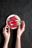 Gorący chili pieprzu projekt na zmroku stołu tła odgórnym widoku Zdjęcie Stock