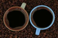 Gorący kawy i filiżanki tło Zdjęcie Royalty Free