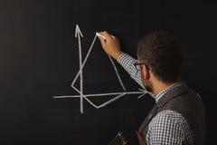 Gorący męski nauczyciel przy blackboard Zdjęcia Stock