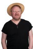 Gorący w średnim wieku mężczyzna w słomianym kapeluszu zdjęcie royalty free