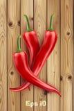 Gorący chili pieprze na starym drewnianym stole Zdjęcia Royalty Free