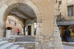 An old commercial street in Gordes. GORDES, FRANCE, April 6, 2018 : Luberon region is a favourite destination for French, British and American visitors because Stock Image