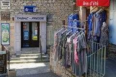 Small stores in the village of Gordes. GORDES, FRANCE, April 6, 2018 : Luberon region is a favourite destination for French, British and American visitors Stock Images