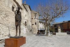 Gordes, the main place of the village. GORDES, FRANCE, April 6, 2018 : Luberon region is a favourite destination for French, British and American visitors Stock Photography