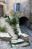 Three-level stone courtyard with an arch and old window stock photo