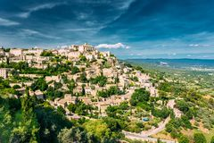 Gordes, Provence, France. Beautiful Scenic View Of Medieval Hilltop Village Of Gordes. Blue Sunny Summer Sky. Famous Landmark Stock Photo