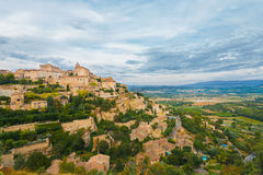 Gordes Provence Hilltop Stone Village Sunset H. A beautiful valley below at Gordes, a picturesque medievel hilltop stone village in Provence, France.  Horizontal Royalty Free Stock Images