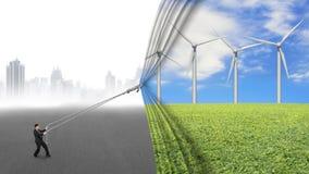 Gordijn die van de windturbines van de zakenmantrekkracht het open grijze citysc behandelen Stock Afbeelding