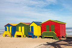 Gordons Bay beach huts. Row of four colorful beach huts by sea at Gordons Bay near Cape Town South Africa Stock Image