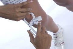 Gordura de medição Foto de Stock
